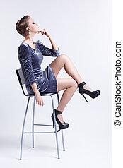 brunette on bar stool