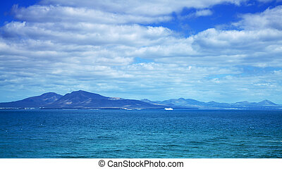 Canary Islands, sea ferry on the background of Lanzarote
