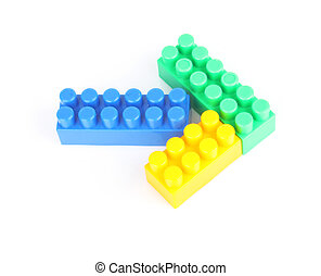 plastic arrow - Plastic building blocks on white in form of...