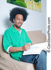 African American studying in livingroom