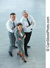 Successful leaders - A business team with pretty leader in...