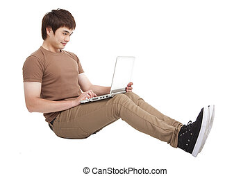 Happy young man using laptop