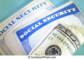 SS cards and cash - U.S. Social Security cards and money,...