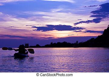 Kayak at sunset, Thailand