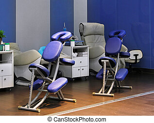 Massage salon - Several chairs for massage in wellness salon