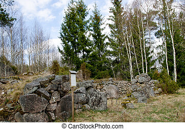 Ruin with information board in forest