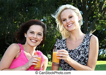 Lovely Women Drinking Wine Outdoors