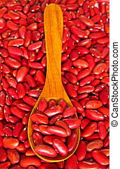 Red beans over wooden spoon