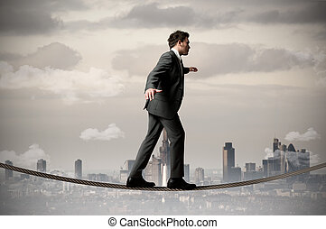 Businessman on the rope - Businessman is balancing on a rope