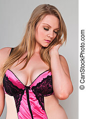 Blonde - Pretty young plus size blonde in pink lingerie