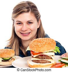 Happy woman with hamburgers