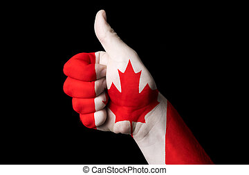 canada national flag thumb up gesture for excellence and achieve