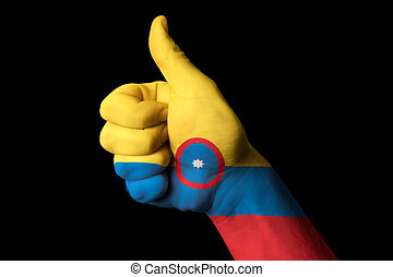 colombia national flag thumb up gesture for excellence and achie