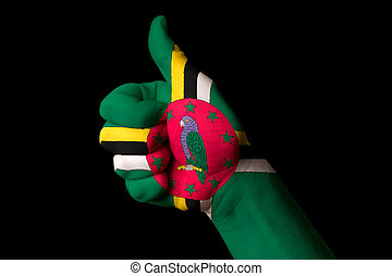 dominica national flag thumb up gesture for excellence and achie