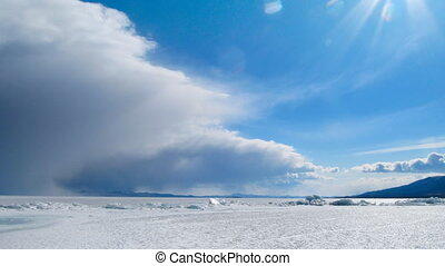 Ice and clouds - Winter Baikal landscape Ice and clouds