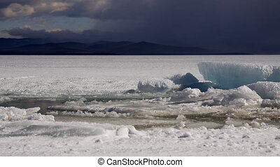 Ice and clouds - Winter Baikal landscape. Ice and clouds