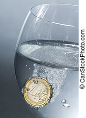 Euro effervescent - A one euro coin in a glass full of water...