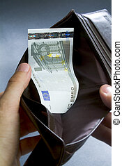 Empty wallet - hands looking for in a wallet which has only...