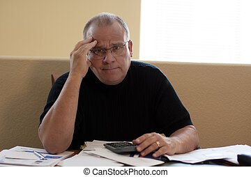 mature male worried and depressed about bills