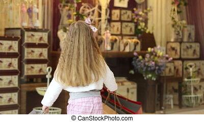 Little girl loves shopping