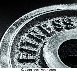 Fitness text close up - Iron text of the word fitness