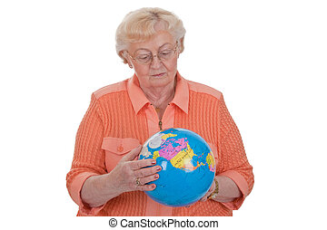 Travel bug - Elderly woman looking at a globe in her hands
