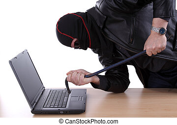 Computer hacker - Masked man with crowbar breaking up a...