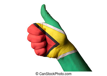 guyana national flag thumb up gesture for excellence and achieve