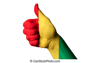 guinea national flag thumb up gesture for excellence and achieve