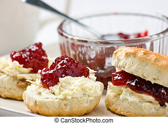 Home-baked scones with strawberry jam and clotted cream. -...