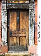 Old Oak Door. - Old Oak door, frame, and window of tudor...