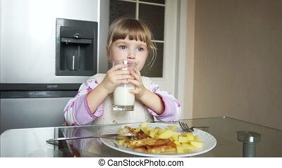 Girl drinks milk and showing Ok