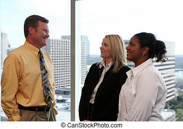 Business Team In Office - Business Team working in a...