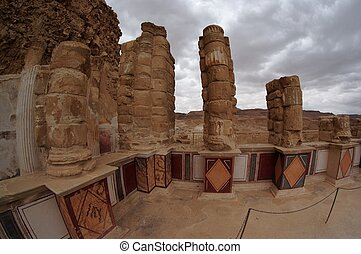 Fisheye view of colonnade of ancient Masada palace of King Herod on cloudy day
