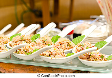 Larb chicken salad. Traditional Thai food, with ground...