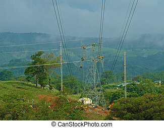 Electrical Linemen - Gang of electrical linemen working on a...