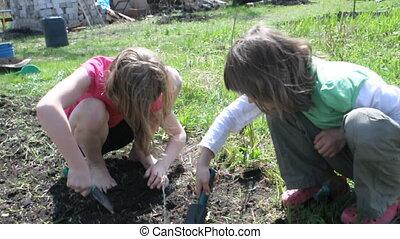 kids working, digging, helping - elementary kids working,...