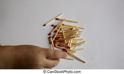 matches - hand collects the child matches
