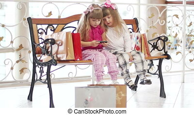 Two girls sitting on the bench afte