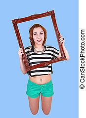 Kneeling girl with picture frame.