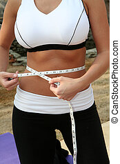 Fitness - Woman measuring herself after an outdoor workout