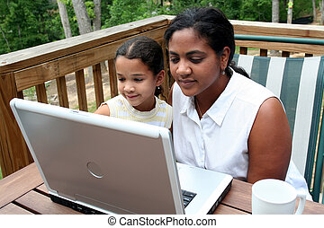 Family on Computer - A mother with her children use the...