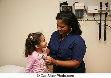 Nurse Checks Young Patient - Hispanic nurse checks white...