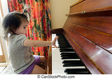 Baby Childhood - Music - Little sweet girl plays piano