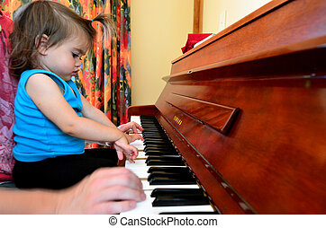 Baby Childhood - Music - Little sweet girl plays piano with...