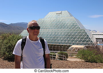 Man at Biosphere 2 - Older Caucasian man traveling on...