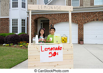 Lemonade Stand - Children selling lemonade in front of their...