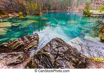 Blausee, Switzerland - Rock - Rock formation at the crystal...