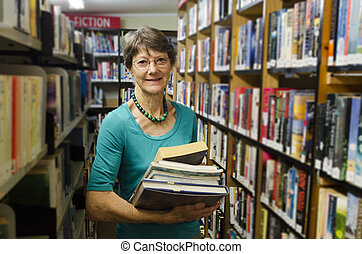Jobs and Proffesions - Librarian - A woman librarian holds...