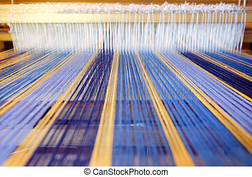 Craft and Art - Weaving - An homemade loom white threads.